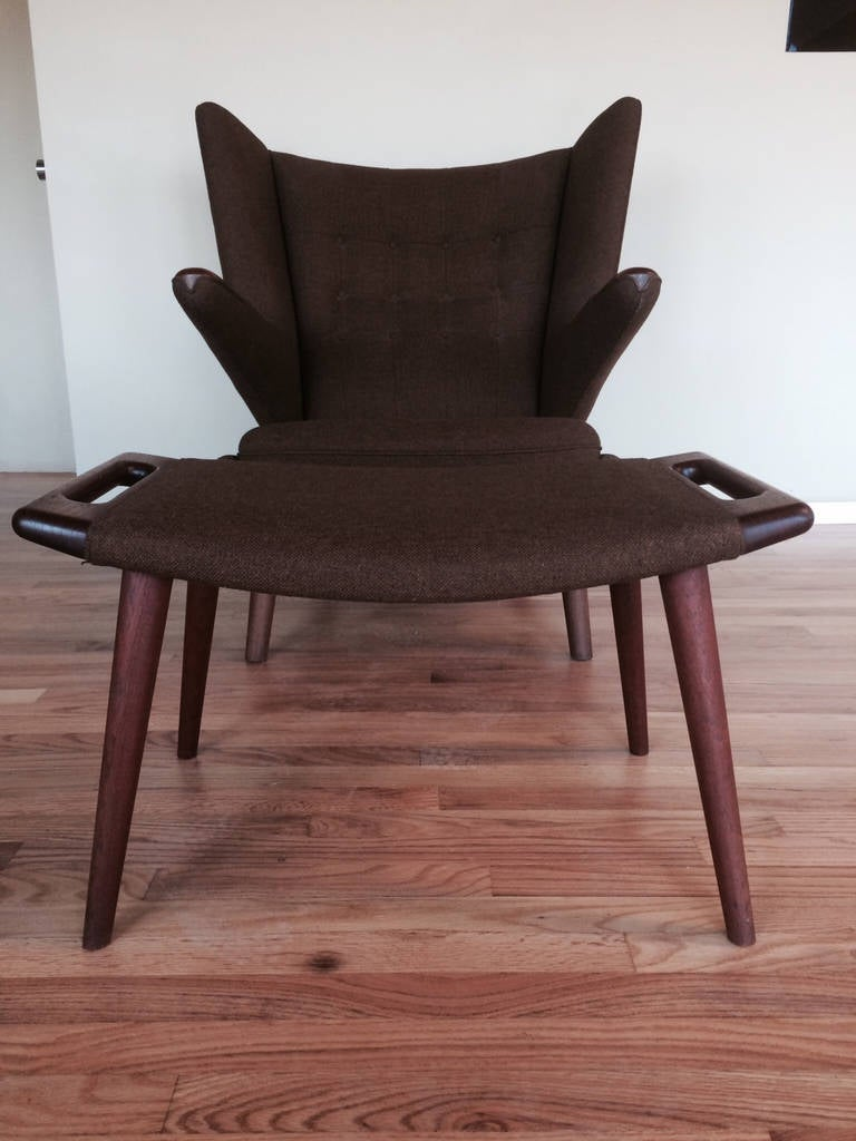 A rare find-all original Hans Wegner papa bear chair and ottoman. Museum quality-original fabric, brochures from AP Stolen, etc. Purchased in the 1960's.
