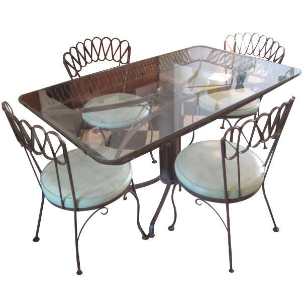 A wrought iron outdoor dining set by salterini with bar for Wrought iron dining set outdoor