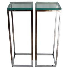 A Pair of Chrome And Glass Pedestals