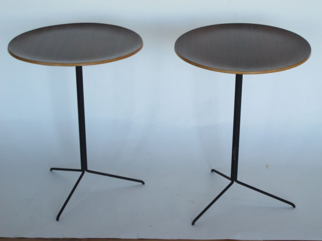 A pair of occasional tables by Osvaldo Borsani for Tecno. Tops in laminated rosewood (palisander).