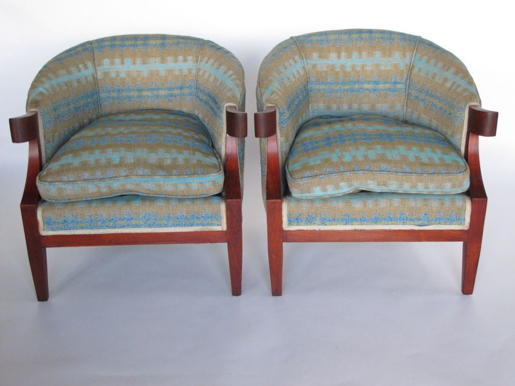 A pair of stylish armchairs by Windsor White and William Millington from The Continental collection for Baker. Mahogany frames in satin reddish-brown finish. Down cushions.