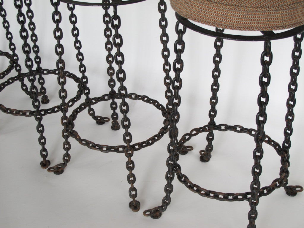A set of four wrought iron chain link barstools at stdibs