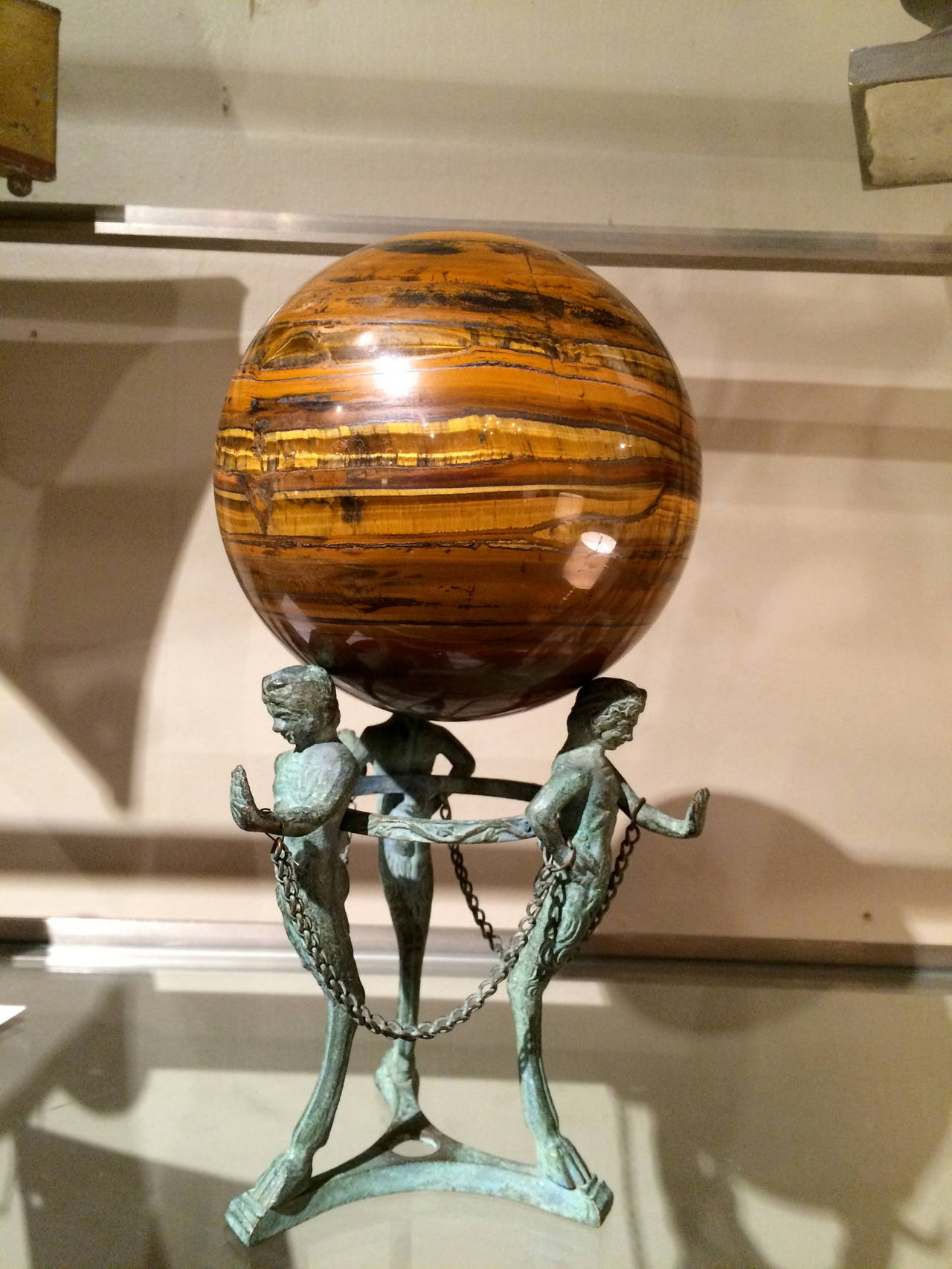 A beautiful agate orb on an Italian bronze 'Grand Tour' Pompeian style tripod stand depicting three faun herms with hoof feet. Lovely Verdigris patina.