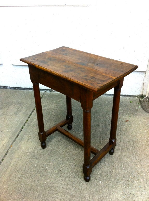 All original Italian baroque walnut side table with turned legs and a single drawer. Great color with warm patina.