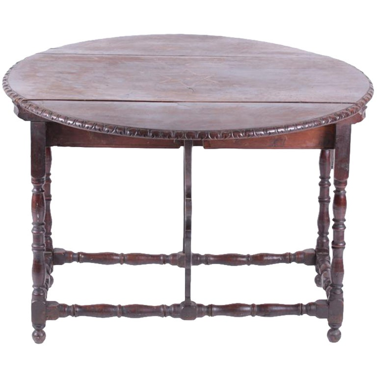Spanish baroque walnut drop leaf table at 1stdibs for Spanish baroque furniture