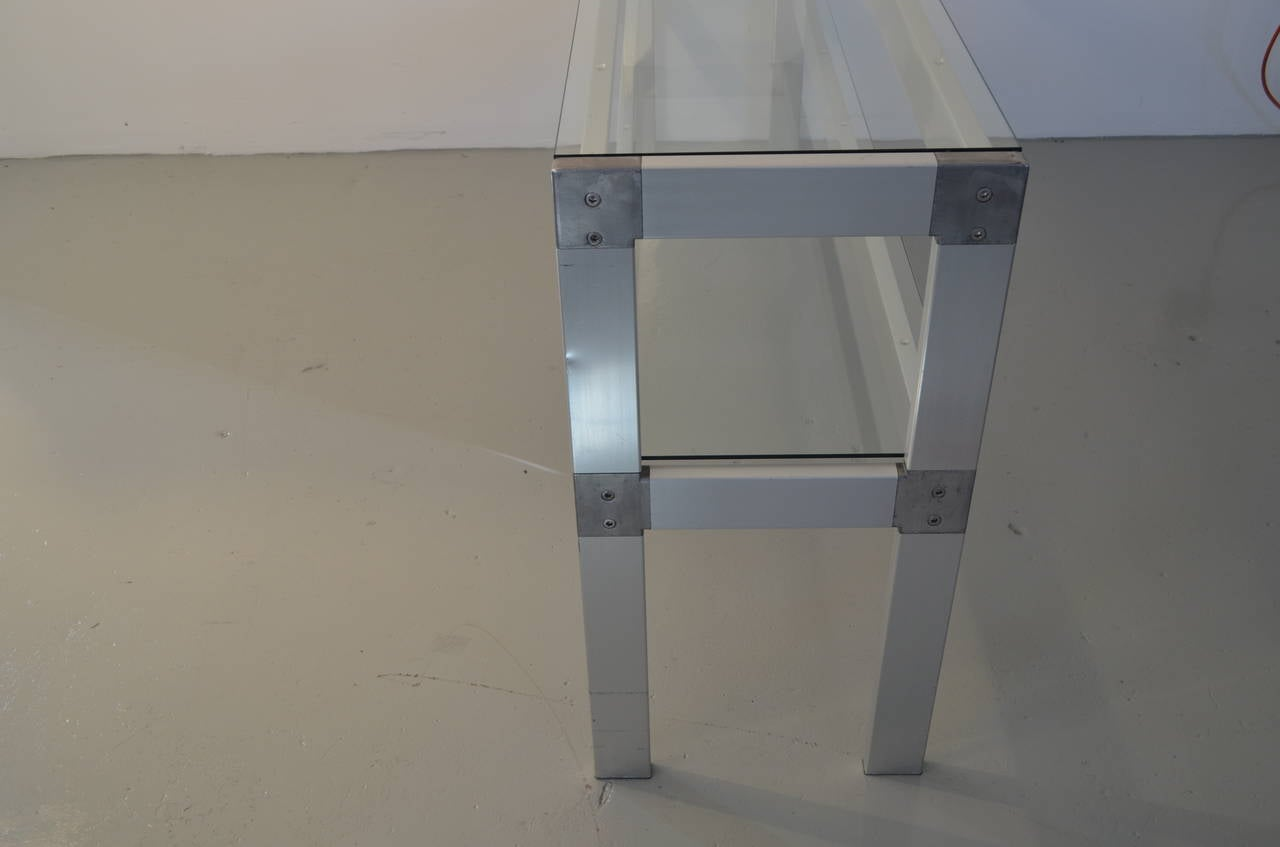 The double-tiered glass top console is in very good condition, the top glass shelf and the second shelf were just replaced.