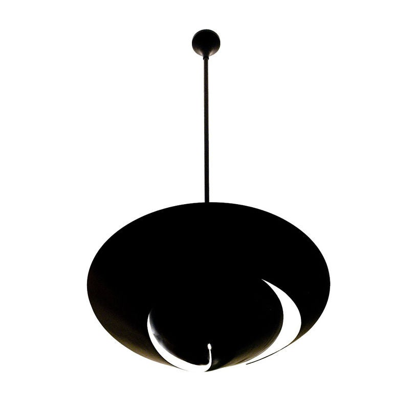 A snail shell provides the inspiration for this lamp with its swirling cutout in the circular shade. Light projects downward through the opening while the shade causes light to reflect from the ceiling. 33 1/2