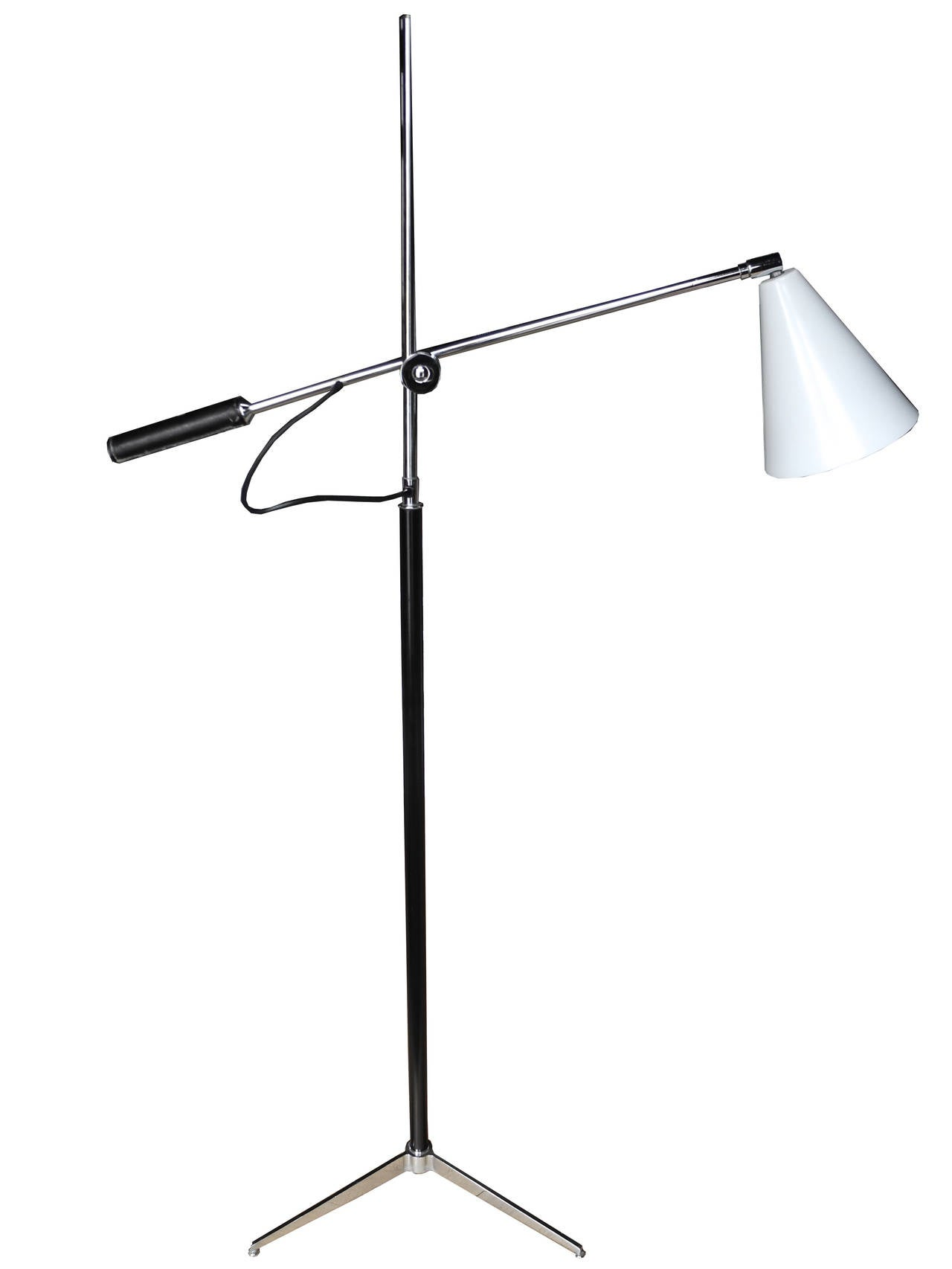 This is a tripod chrome base metal lamp designed in the style of Gino Sarfatti, to move up and down. The handle on the arm has a leather sleeve and the cone shade is made of spun aluminum painted white. The height of the center rod is 58