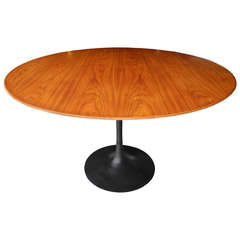 Modern Walnut and Cast Iron Round Tulip Dining Table by Eero Saarinen for Knoll