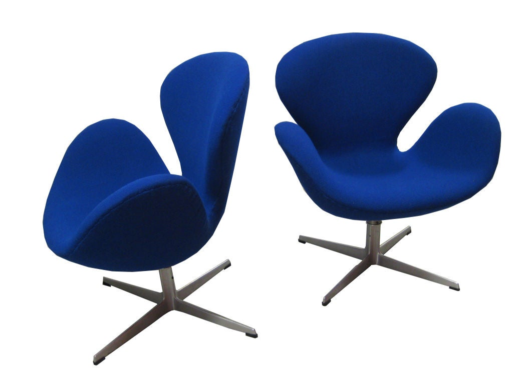 Make a statement with these iconic royal blue Arne Jacobsen chairs for Fritz Hansen. They tilt and swivel and have an adjustable height of 3-4 inches. They are newly upholstered and too good to pass up!<br /> <br /> For more art and furniture