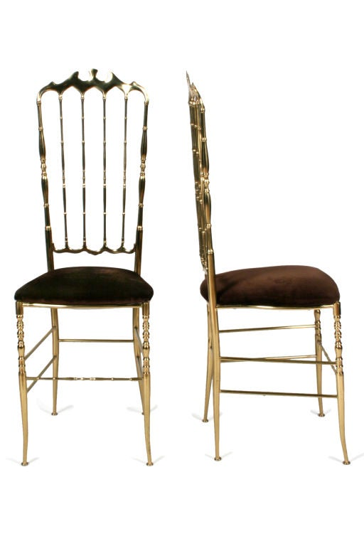 A wonderful pair of brass side chairs with shapely crest rails and spindled backs and with velvet upholstery. By Chiavari, Italian, circa 1950.