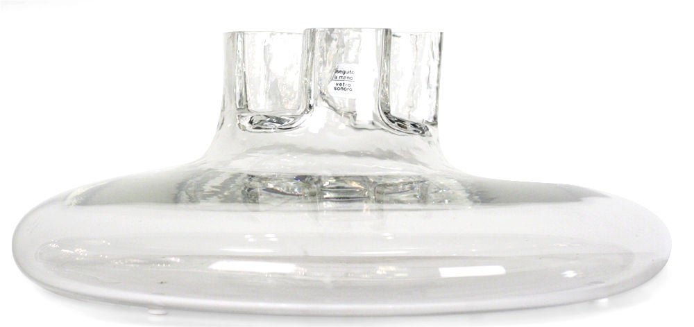 A beautiful handblown glass vase with a four-leaf clover neck and a squat round body. Retains paper label