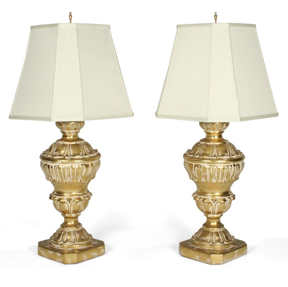 A classically inspired pair of plaster table lamps, massive in scale with a baluster form, carved acanthus leaf details and a parcel-gilt finish. By Frederick Cooper, American, circa 1955.