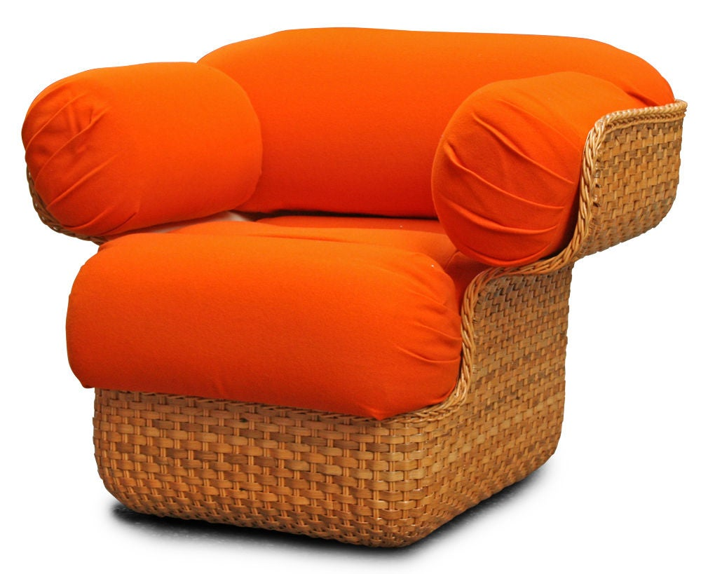A mod armchair comprising a woven cane fiberglass impregnated shell in an oversized curvy cube form with billowy arms, seat and back in orange velvet upholstery, Italian, circa 1960. Price is COM.