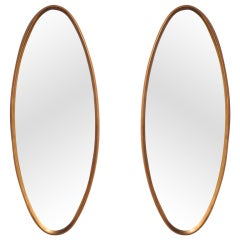 Pair of Oval Water-Gilt Frame Mirrors by La Barge