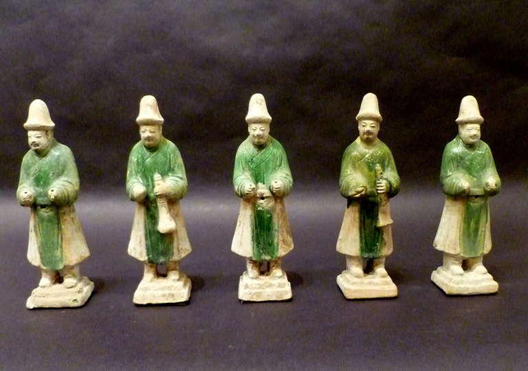 A set of six green glazed pottery statue of attendants, Ming dynasty 1368-1644