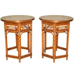 A Pair Of Round Bamboo End Tables With Black Lacquer Tops