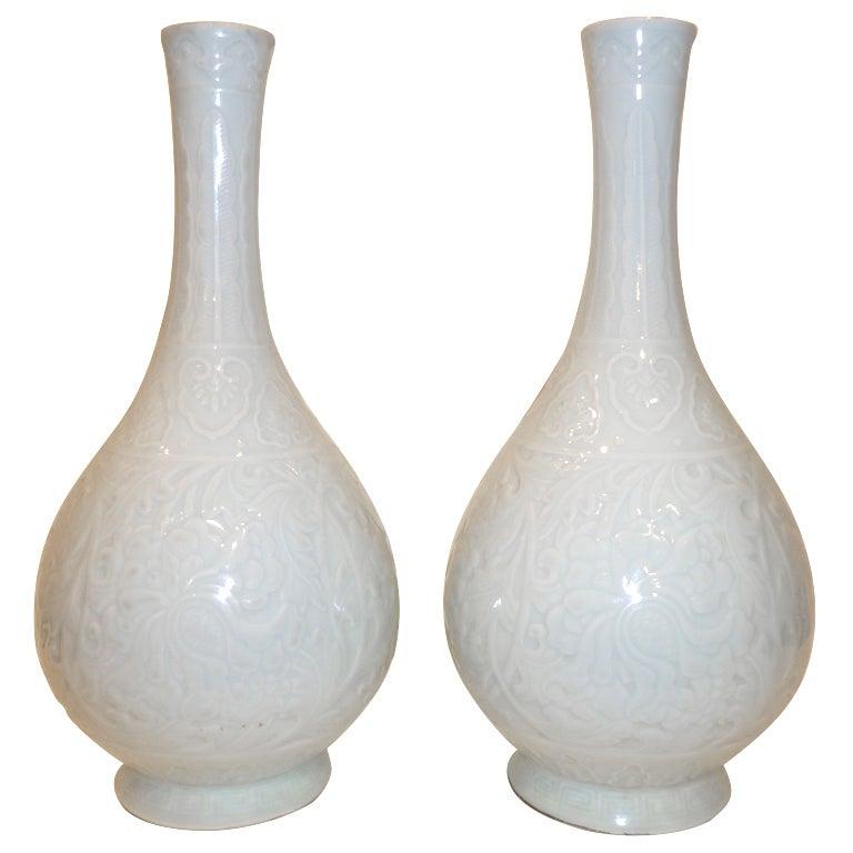 A Pair of Fine Porcelain Vases with Underglaze Floral Motif