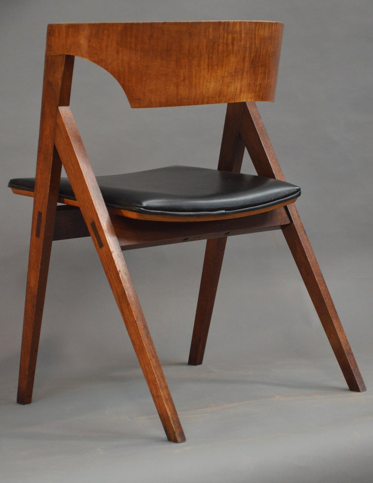 David N. Ebner's early dining chair in the style of Danish modern, walnut and curly maple dining room chair. Leather seat (your fabric of choice) crafted to order; one or more.