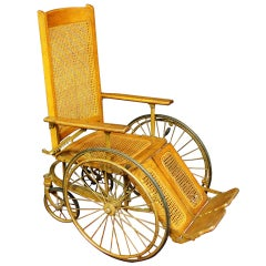 A Late 19th century Oak Wood & Cane Wheel Chair