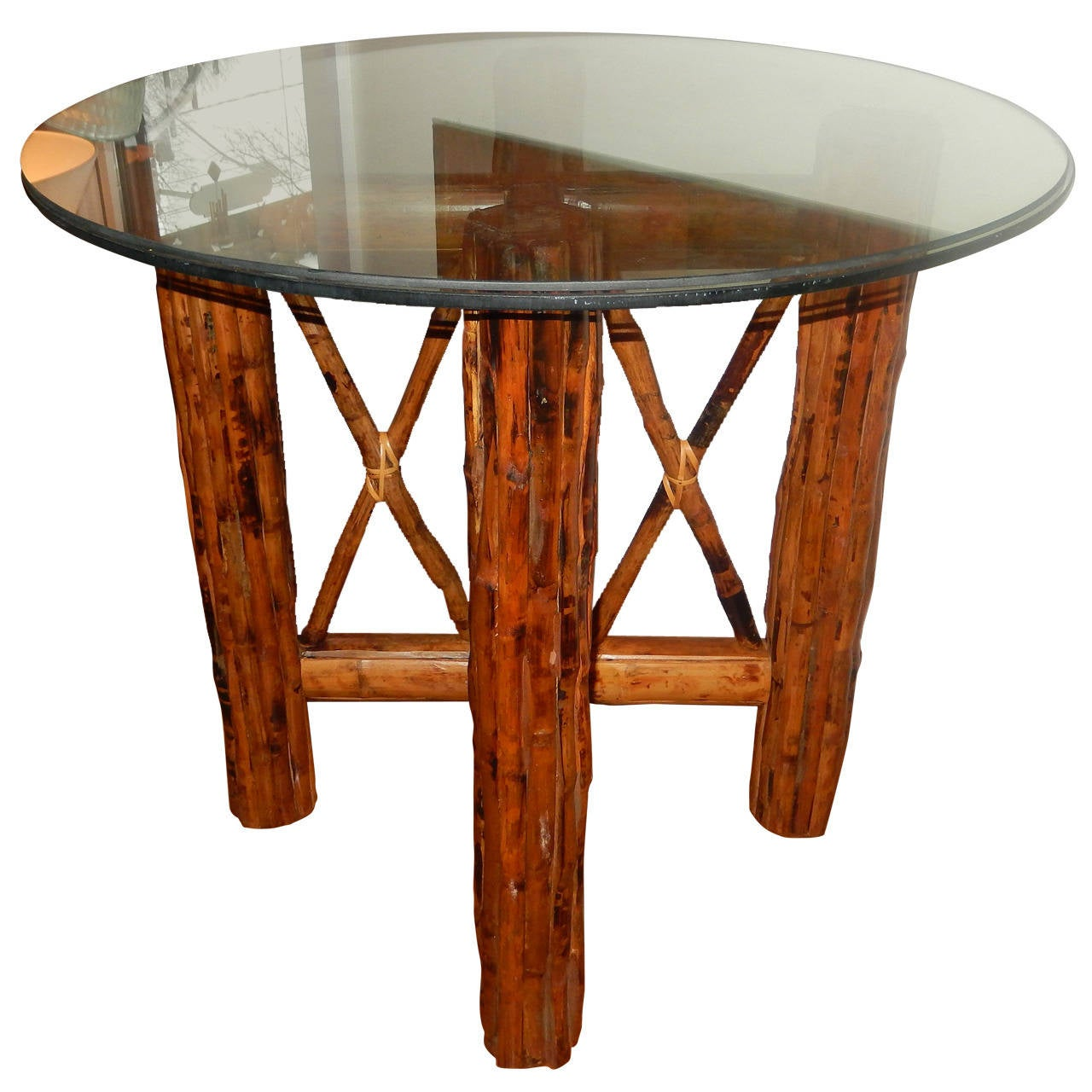 Bamboo and tortoiseshell finish circular dining room table for Dining table finish