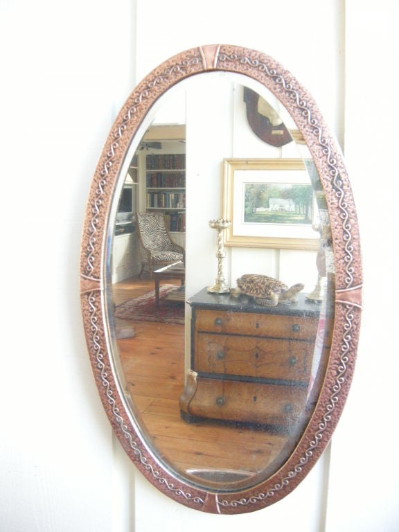 English Arts & Crafts decorated copper framed mirror. Original back in place, Bevelled glass mirror also original with silver backing (some silver loss showing through). A truly fabulous mirror for the Arts & Crafts enthusiast. Check out the other