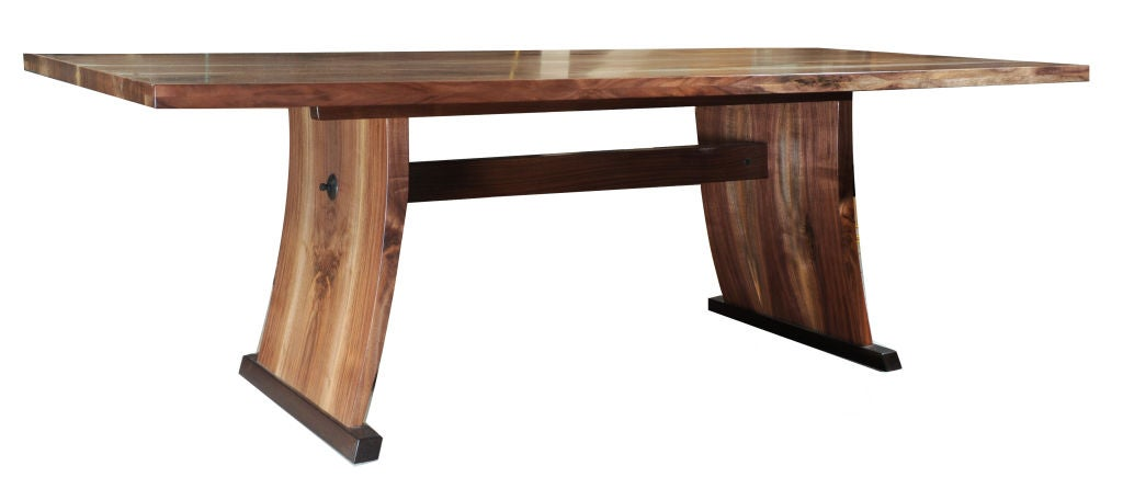 A magnificent table designed by internationally renowned American Studio Craft Artist, David N. Ebner. Made from American walnut and wenge woods. Bookmatched on all sides, with blued steel details, wenge wood feet, American walnut wood top and