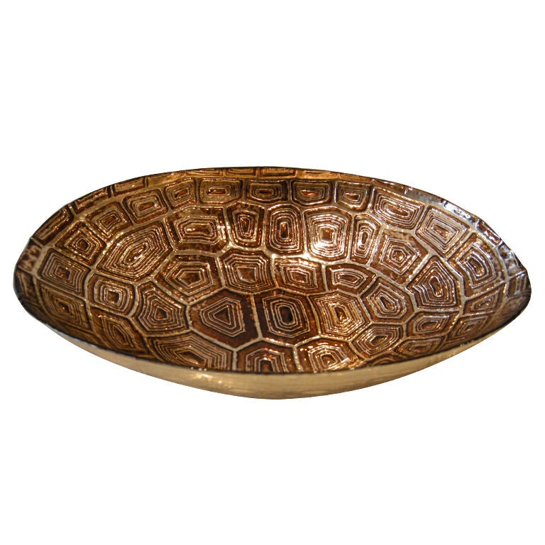 An oval shaped silver and glass faux tortoise shell bowl