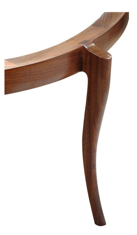 Elegant and beautifully crafted dining room table by American studio Craft artist David N. Ebner. Shown in walnut wood, however other woods are available (price may vary with size and wood choice).  Note: All works signed by the artist, David N.