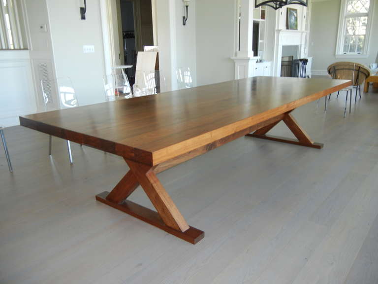 This table can be crafted to any size; the size showing is eight feet long. Made of solid walnut wood, showing knots and matched grain, alternate woods available. On request, price will vary based on size and woods.