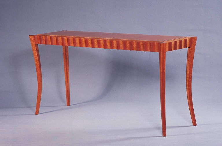 A console table or sofa table by studio craft artist David N. Ebner. The above woods are sapele and pomele woods, size and wood type will determine cost.  Note: All works signed by the artist, David N. Ebner.  Please see the newly published book