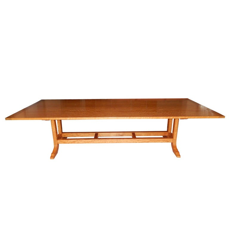 A magnificent one of a kind dining room table or conference room table by studio Craft artist David N. Ebner. This table is cut from one continuous length of solid Makore wood from Sierra Leone, Africa.