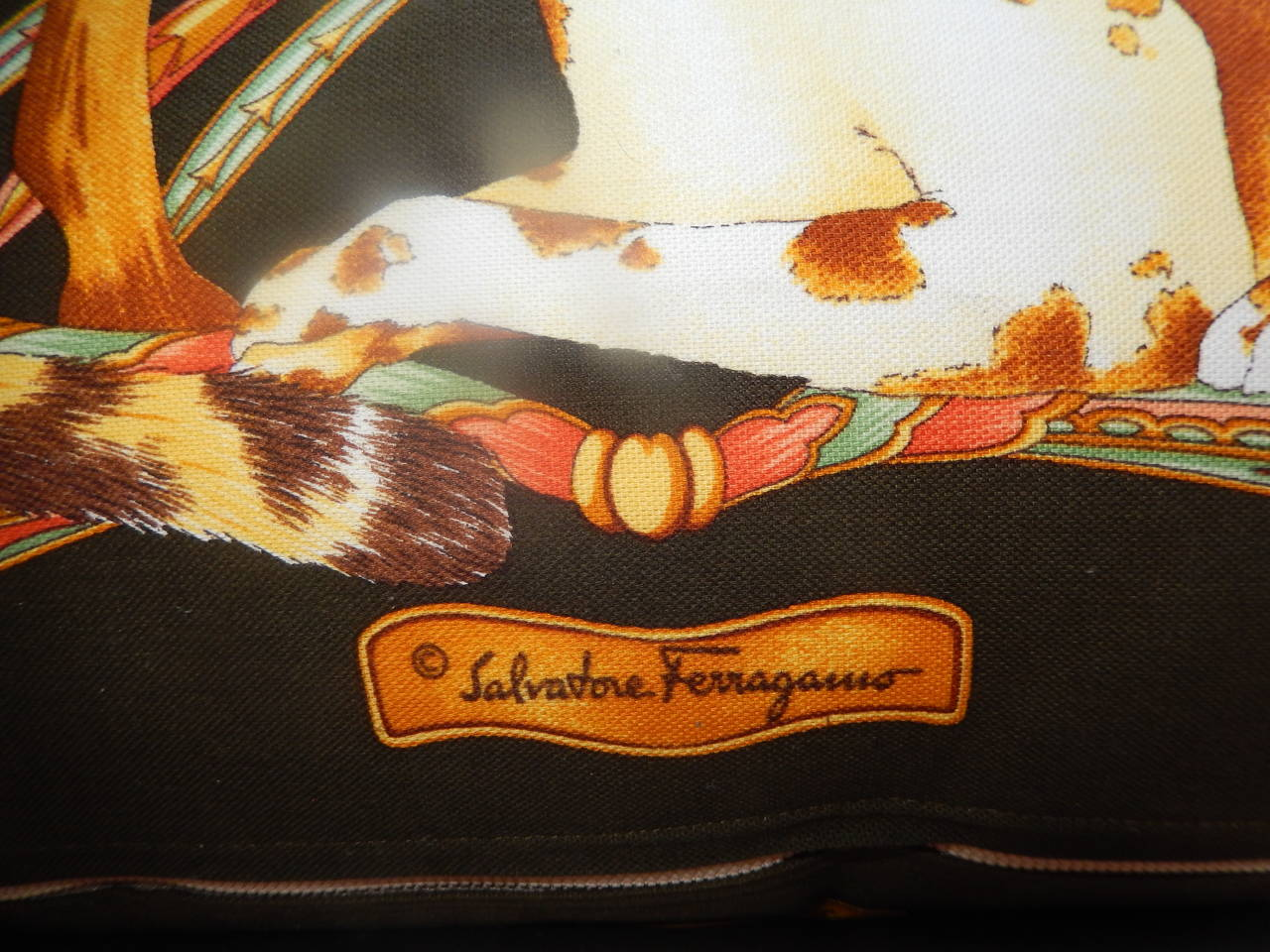 A vintage/Classic Salvatore Ferragamo large pillow, check out our other listings, as there are three pillows by Ferragamo.