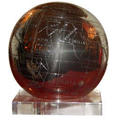 A Mid-Century Chrome & Lucite Rotating Globe