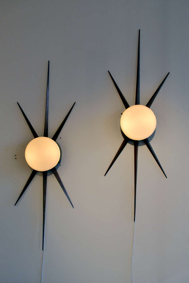 A rare set of sconces by Gio Ponti (1891-1979) for Arredoluce, Italy. The sconces are from the early 1950s and are in wonderful condition.