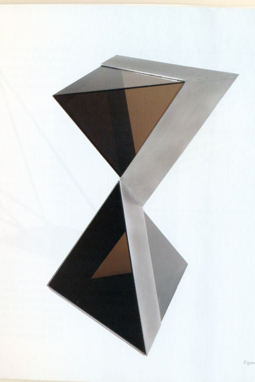 A unique and modern Minimalist sculpture. It is made of interlocking aluminium slates that cross with two opposing constructions of smoked Lucite.