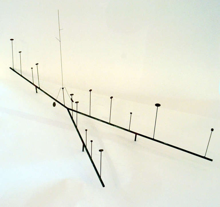 An early and rare Kinetic sculpture by Harry Bertoia. The sculpture is made of steel rods with smallish sprouts that seem to grow from the structural base. There is a delicate Kinetic element that can be placed upon the sprouts which balances and