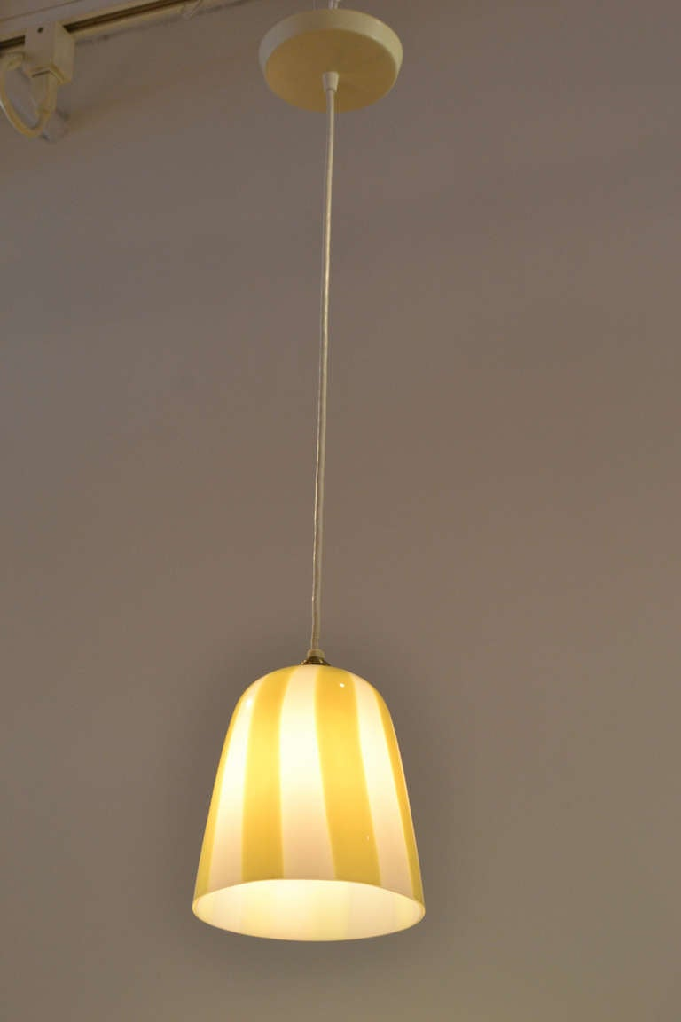 A playful petite striped pendant by Venini, Italy. The pendant cord height can be adjusted for lower ceiling drops.