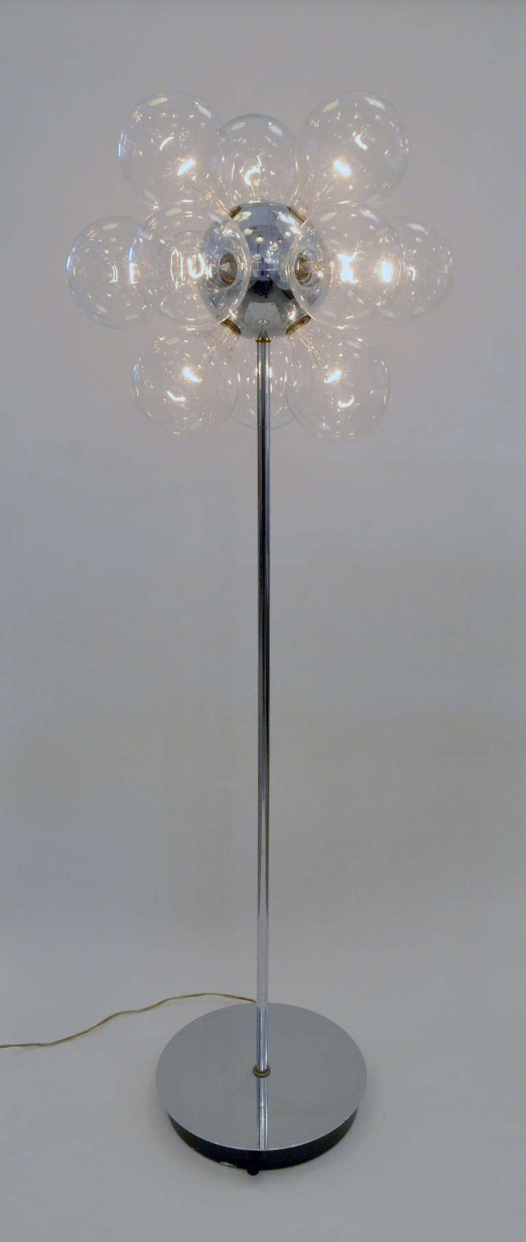 A fun and retro modern Sputnik floor lamp. The lamp as multiple sockets that work best with large vanity bulbs for added effect and fullness. There is a dimmer for adjustable mood lighting.