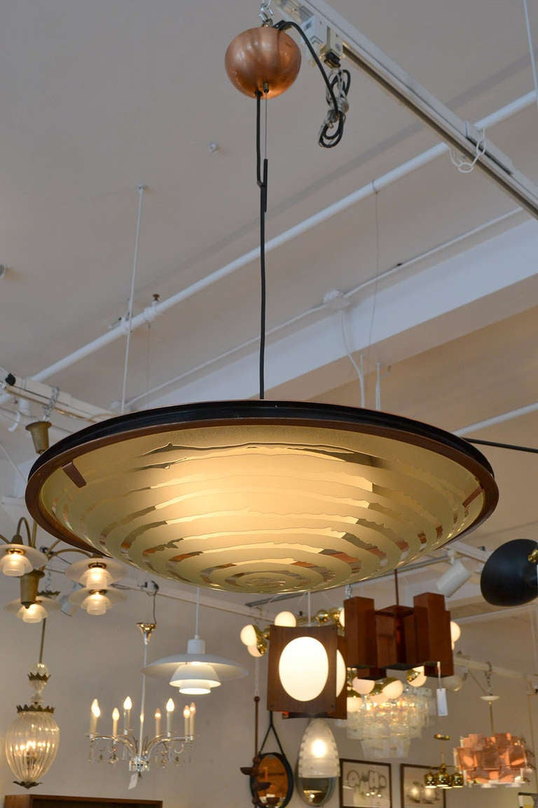 This copper and glass fixture has spiraling acid etched detailing that gives it an unusual and impressive presence.
