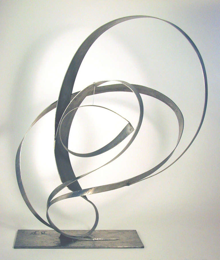 Beverly Pepper is an American sculptor who's work is possessed by many private and institutional collections worldwide. Her work engrosses the sculptures of the minimal era and corporate art aesthetic. This particular work evokes the sculptural