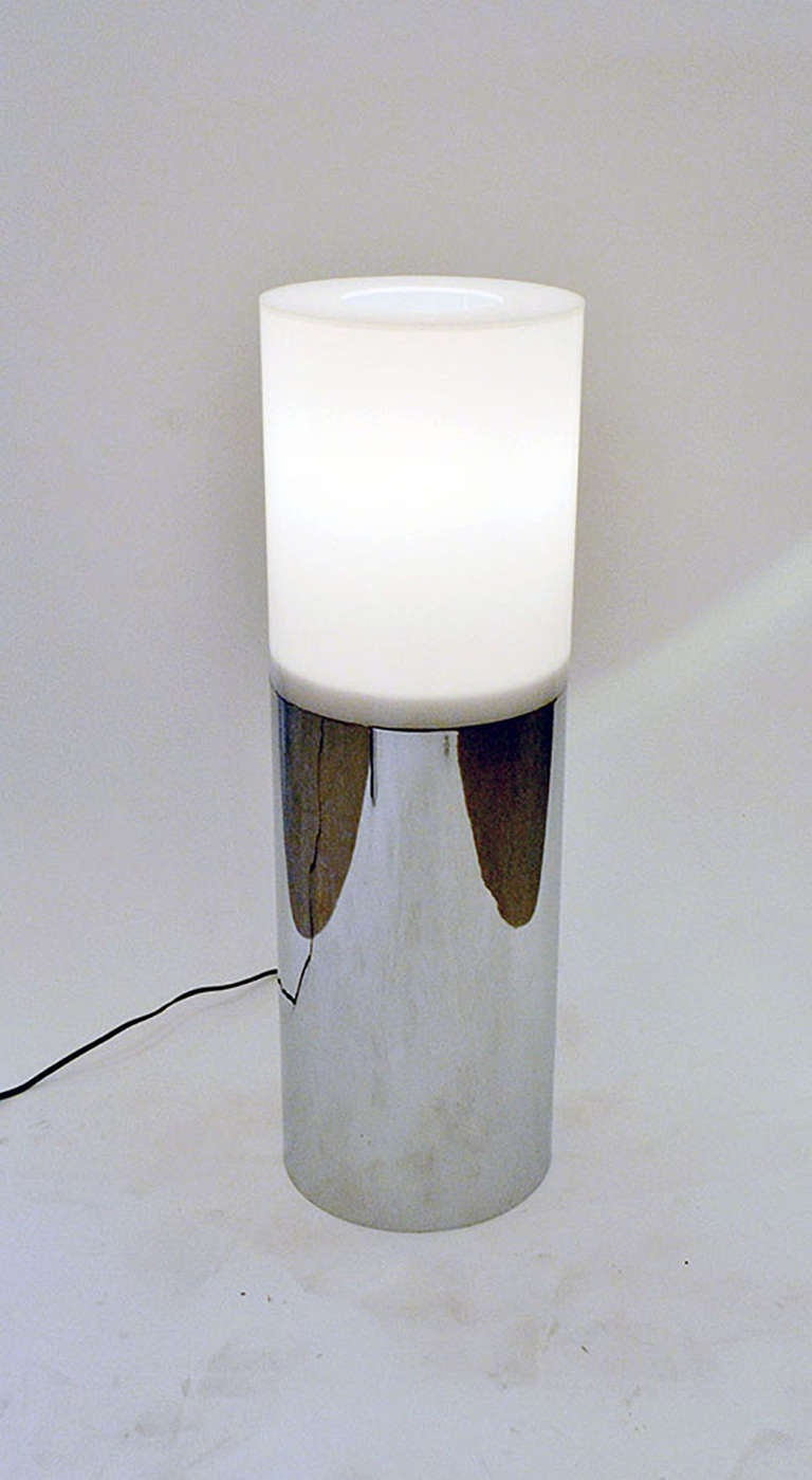 An austere and delightful lamp by Robert Sonneman. The lamp is bisected in two sections. The top is the translucent reflector and the bottom is comprised of a cylindrical chrome base. The lamp has a dimmer for multiple mood settings.
