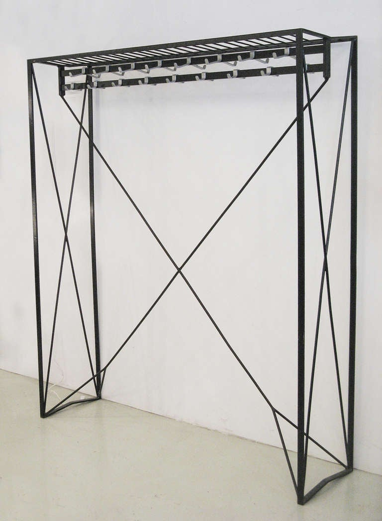 Midcentury coat rack in lacquered iron with attached hooks by Roland Rainer for the Wiener Stadt Halle, (City Hall) Vienna, 1956.
