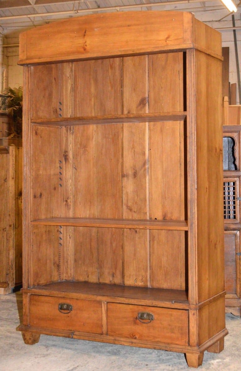 Bookcase with adjustable shelves and two drawers with hand-cut dove-tails in all four corners.