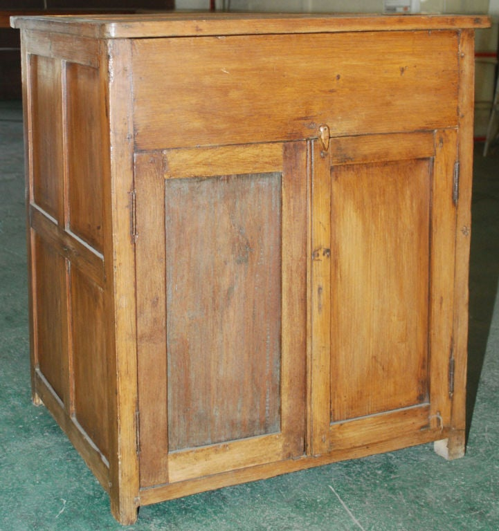Nicely made teak cabinet with hinged top and two doors. We have a nearly identical second piece for a matched pair.