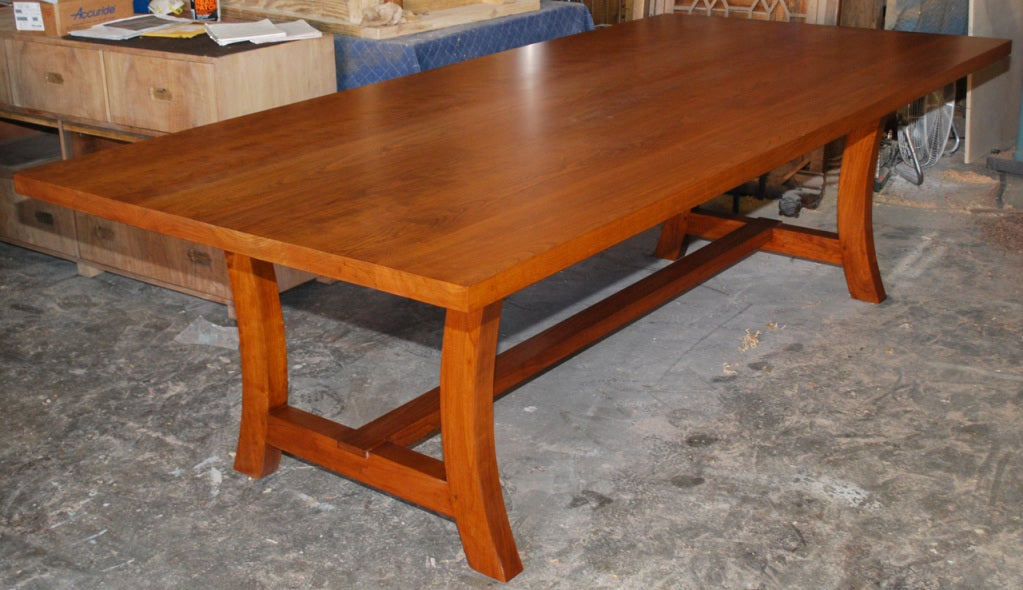 This solid cherrywood trestle table is seen here in 102