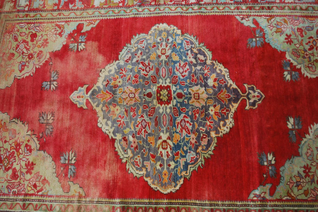 This antique Russian rug is finely knotted with a center medallion.