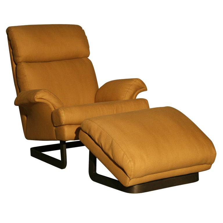 A Comfortable Modern Chair And Ottoman By Metropolitan At
