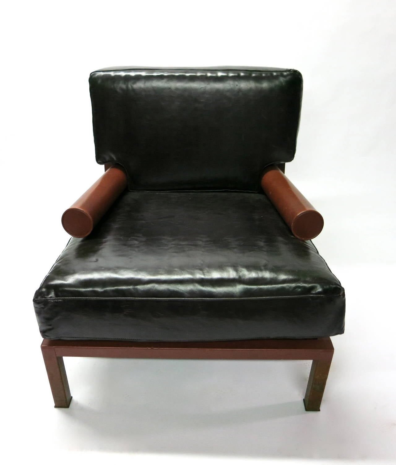 Leather chair with dark brown oversized cushions in brown leather. The round arms rectangular back and seat all in red leather. Designed in 1987 by Antonio Citterio for B&B Italia.
