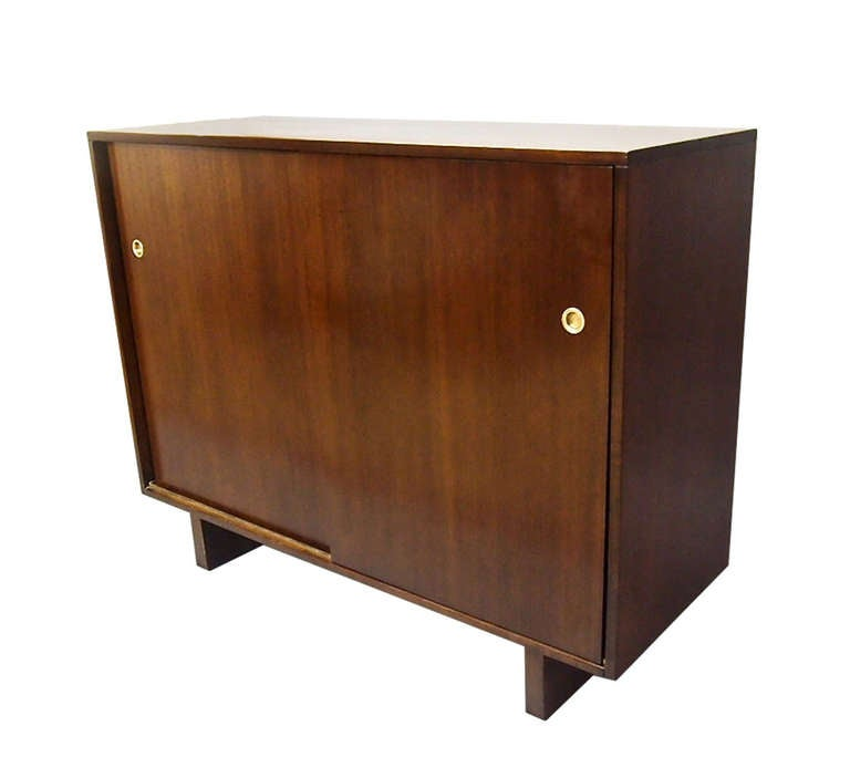 One made for lady's one made for gentleman both have sliding doors with brass hardware that reveal drawers and space on each side that differ in each cabinet. The difference is in the interior drawer size tie rack and open space for shoes. The